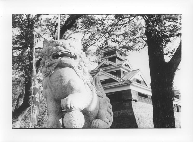 Koma Inu, Kato Shrine, Kumamoto City, with Kumamoto Castle in the background